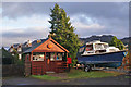 NG8033 : Post Office and boat by Richard Dorrell