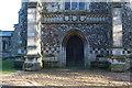 TF8709 : All Saints, Necton - West doorway by John Salmon
