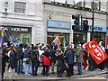 TQ2980 : Protest outside Uganda House, Trafalgar Square by pam fray