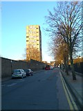 TQ3580 : Looking north on Glamis Road to tower block on The Highway by Shazz