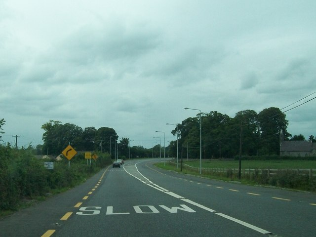 Approaching a dangerous bend on the N52 at Four Roads Cross Roads
