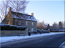 TF1505 : High Street, Glinton, in the snow by Paul Bryan