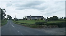N7186 : Bungalow at the junction of the Newcastle and Feagh Roads by Eric Jones