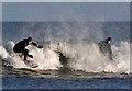 NT7574 : Surfing at Thorntonloch by Walter Baxter