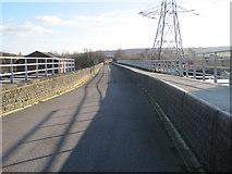 SE2320 : Old railway line over River Calder by Nigel Thompson
