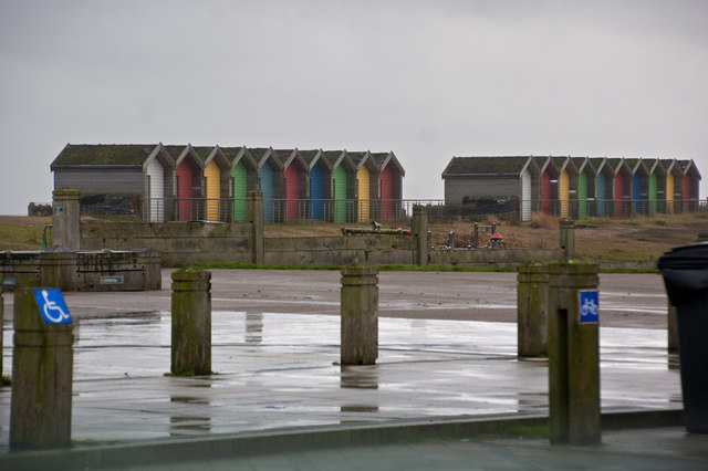Sorry looking beach huts - not their type of weather