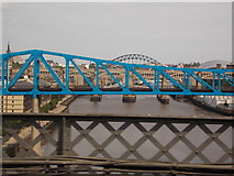NZ2463 : Newcastle upon Tyne: crossing the river by train by Chris Downer