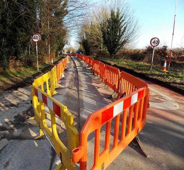Yellow and orange barriers along Cirencester Road, Tetbury