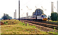 TF0908 : Down IC125 express on the electrified ECML approaching site of Tallington station, 1991 by Ben Brooksbank
