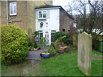 TQ1667 : Clematis Cottage seen from St Nicholas Churchyard, Thames Ditton by Marathon