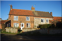 TG2834 : Cottages in Trunch by N Chadwick