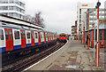 TQ2474 : Trains meet at East Putney station, 1994 by Ben Brooksbank