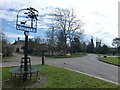TF1005 : Village sign in Ashton by Richard Humphrey