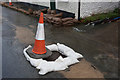 SU6414 : Manhole and sandbagging outside Cricketers Cottage by Peter Facey