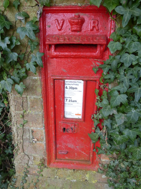 Victorian post box next to Booton church