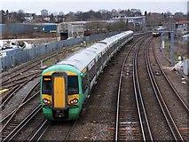 SU4212 : Train departing level crossing at Northam by David Martin