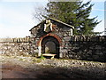 H6064 : Crest in wall and fountain, Dunmoyle by Kenneth  Allen