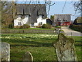 TL2378 : Thatched houses near the church in Abbots Ripton by Richard Humphrey
