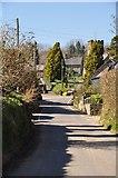 SS9531 : Brompton Regis : Village Road by Lewis Clarke