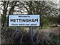 TM3790 : Mettingham Village Name sign by Adrian Cable