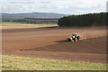 NJ3065 : Sowing near Corbiewell by Anne Burgess
