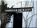 TM3691 : Thomas & Jackson sign on Ellingham Mill by Adrian Cable