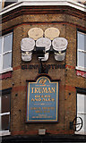 TQ3084 : Public house advertising signs, Holloway by Jim Osley