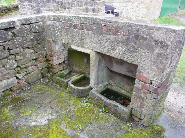 Feeding troughs in a disused pigsty