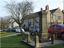 SK1971 : War memorial and houses in Great Longstone by Trevor Littlewood