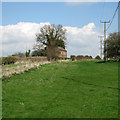 TL1281 : Farm cottages at Little Gidding by John Sutton
