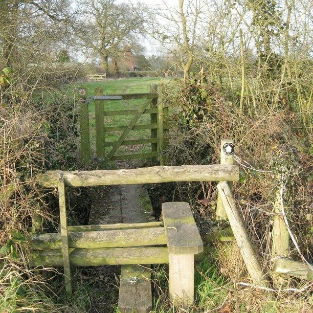 A ditch crossing guarded by a gate and a high stile south of Valley Farm