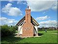 SJ4259 : Cruck Framed Barn on Aldford Village Green by Jeff Buck