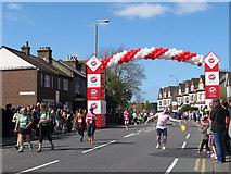 TQ4077 : London Marathon 2014: first mile marker by Stephen Craven