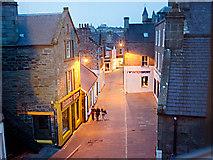 HU4741 : Early evening, Commercial Street, Lerwick by Julian Paren