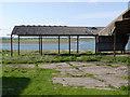 SK7942 : Derelict barn and lagoon, Kilvington by Alan Murray-Rust