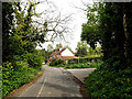 TM4089 : Lodge Farm Lane & footpath by Adrian Cable