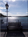 SH5873 : Bangor: bench and lamppost on the pier by Chris Downer