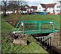 SS7597 : Green footbridge over Gnoll Brook, Neath by Jaggery