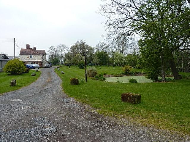 Duckpond and buildings at Sundorne Farm