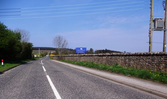 A957 heading NW off its viaduct over the A90