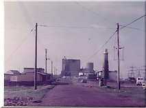 TR0916 : Dungeness power station and old lighthouse, 1982 by David Howard