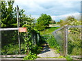 SU9804 : View over lake from railway crossing by Shazz