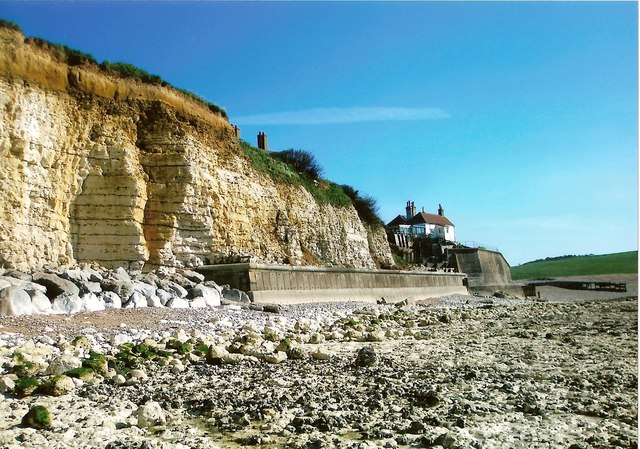 Riprap and sea wall by the coastguard cottages at Cuckmere Haven