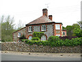 TG0539 : Flint and brick house in Blakeney Road by Evelyn Simak