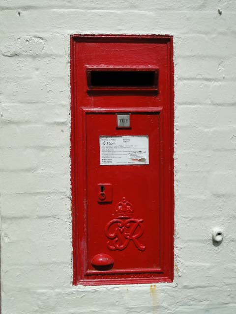 Post box in the wall of the old Post Office