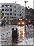 SK3587 : Sheffield: a tram descends High Street by Chris Downer