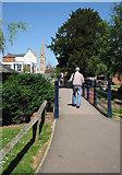 SP7387 : Market Harborough: footbridge to spire by John Sutton