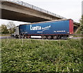 TL1395 : Continental trucker passing Alwalton by Michael Trolove