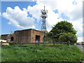 TA1374 : Mast and disused, brick buildings by Pauline E