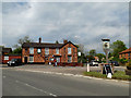 TM1274 : The Yaxley Cherry Tree Public House & Village sign by Adrian Cable